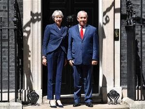 British Prime Minister Theresa May (L) greets Israel's Prime Minister Benjamin Netanyahu outside 10 Downing Street in London on June 6, 2018. (AFP/ File)