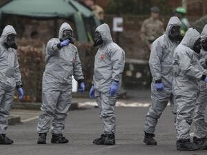Military personnel wearing protective coveralls work behind a police station in Salisbury following an attack on a former Russian spy by a nerve agent. (AFP/ File Photo)
