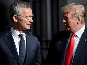NATO Secretary General Jens Stoltenberg (L) stands next to US President Donald Trump ahead of a NATO Summit in Brussels on July 11, 2018. (Brendan Smialowski/ AFP)
