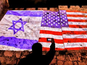 The American and Israeli flags projected onto Jerusalem's Old City Walls. Ahmad Gharabli/AFP