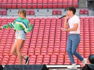 Taylor Swift surprised fans by bringing out Niall Horan on stage. (Twitter)