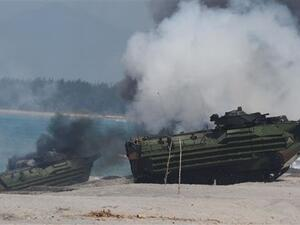 Amphibious Assault Vehicles (AAV) of the US marines emit white smoke during an amphibious landing exercise at the beach of the Philippine. (AFP/File)