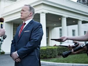 White House Press Secretary Sean Spicer speaks to a reporter about a comparison he made between Syria's President Bashar al-Assad and Hitler during an earlier press briefing at the White House April 11, 2017 in Washington, DC. (AFP/Brendan Smialowski)