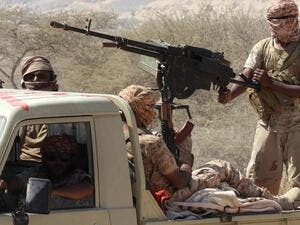 Yemeni fighters loyal to the government ride in the back of a pickup truck while closing in on a suspected location of an Al Qaeda in the Arabian Peninsula (AQAP) leader in February. Saleh Al Obeidi / AFP