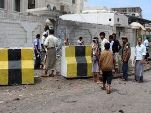 People gather at the site of a car bombing near the Foreign Ministry in Aden on Friday. (AFP/Saleh Al-Obeidi)