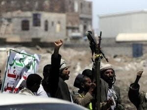 Houthi rebels celebrate the capture of the capital last month (AFP/ File Photo)