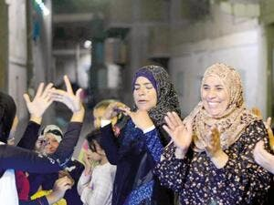 Although Egyptian women play great roles on social occasions as weddings, they are increasing turning their hands to political life  (AFP/File Photo)