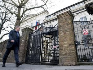 A man passes near the Russian embassy in London (AFP/File Photo)