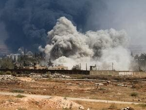Smoke rises from a Syrian regime airstrike on rebel positions inside Aleppo. (AFP/George Orfalian)