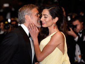 George and Amal are expecting twins in June. (In Touch Weekly)