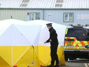 British emergency services put a tent over the bench where Sergei Skripal and his daughter, Yulia, were found (AFP/File Photo)