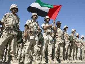 A contingent force from the UAE stand at ease on the tarmac of Kuwait International Airport on Feb. 23, 2003. (AFP/File)
