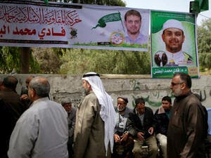 Palestinians gather in mourning outside the family home of 35-year-old professor and Hamas member Fadi Mohammad al-Batsh (AFP/File Photo)