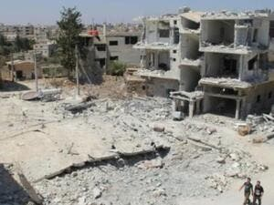 The Syrian town of Deraa, which has seen intensified shelling and aerial bombardment, is just a few kilometers away from Jordan's border town of Ramtha. (AFP/File)