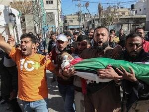 Mourners carry the body of a four-year-old Palestinian boy, who died of Israeli-inflicted wounds, during his funeral in Khan Yunis, Gaza Strip. (AFP)