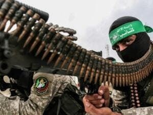 Fighters from the Ezzedine al-Qassam Brigades, the armed wing of the Palestinian Hamas movement, take part in a military show. (AFP)