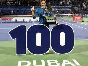 Switzerland's Roger Federer celebrates with the trophy after winning the final match at the ATP Dubai Tennis Championship in the Gulf emirate of Dubai on March 2, 2019. Roger Federer won his 100th career title when he defeated Greece's Stefanos Tsitsipas 6-4, 6-4 in the final of the Dubai Championships.