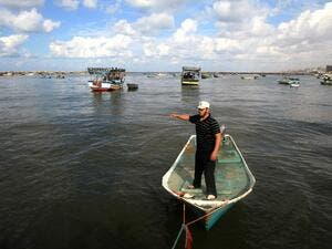 Around 4,000 fishermen work in Gaza, but the Israeli navy has restricted the zone in which they are allowed to fish, and their boats frequently come under attack. (AFP/File)