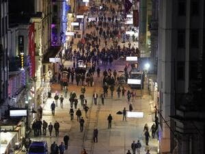 Pedestrians walk down Istiklal Street, a busy shopping and entertainment hub in central Istanbul, on March 20, 2016, a day after a suicide attack. (AFP/Yasin Akgul)