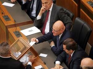 Lebanese MPs seen casting ballots in a parliamentary session. (AFP/File)