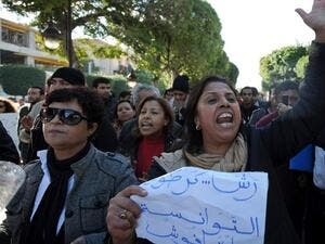 Tunisian women demonstrate in solidarity with the southwestern town of Siliana on Wednesday, in Tunis. (AFP PHOTO / FETHI BELAID)