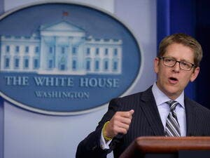 "White House Press Secretary Jay Carney warned that if the new legislation to impose fresh sanctions on Tehran is enacted, ""the president would veto it."" [Getty Images]"