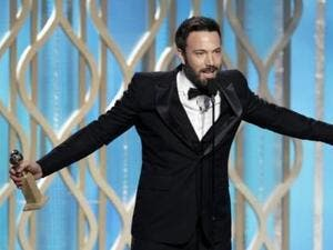 Ben Affleck picks up his Globe with pride.