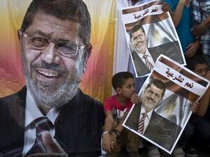 Morsi is charged with collaborating with Hamas and Hezbollah when escaping from prison during the 2011 revolution. (AFP/File)