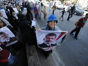 An Egyptian supporter of deposed president Mohamed Morsi holds a portrait of him during a demonstration against the government in al-Nasr street in Cairo on July 30, 2013. (AFP)