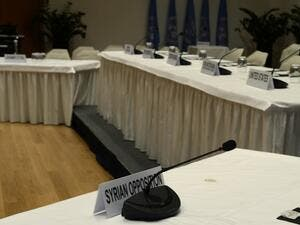 "A picture taken on January 20, 2014 in Montreux shows the place of the Syrian opposition representative in the Syria peace conference room at the conference centre ""Le Petit Palais"", where the Geneva II talks will be held later this week. (AFP)"