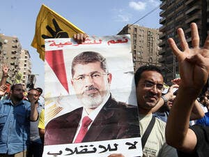 Morsi's first trial in November was adjourned after riots inside and outside the courtroom made proceedings impossible (Courtesy of Al Jazeera)