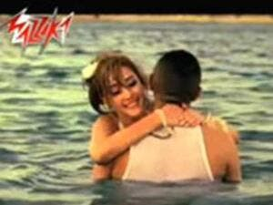 Tamer Hosny in a clinch with Basma Boussil