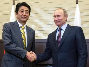 Russian President Vladimir Putin (right) shakes hands with Japanese Prime Minister Shinzo Abe during a meeting on the sidelines of the Eastern Economic Forum. (AFP/ File)