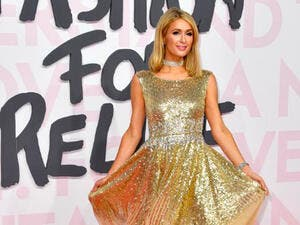 Paris Hilton wowed in a gold sleeveless gown on Sunday night at the Cannes Fashion For Relief gala (Source: YANN COATSALIOU / AFP)