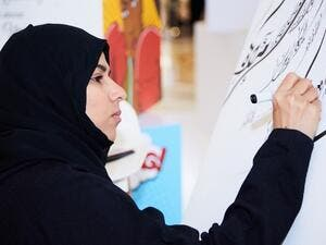 Award winning calligraphy artist, Narjes Noureddine.