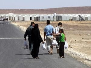 The center will allow Syrian refugees to obtain a one-month leave from the camp and work permit to pursue job opportunities outside the camp. (AFP/ File)