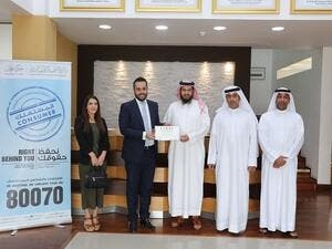During its visit to DED-Ajman's headquarters in the Corniche Building, the business groups awarded a trophy to the Department.