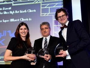 Malek Khalife, NBK's General Manager, Private Banking Group receiving the three awards from Euromoney