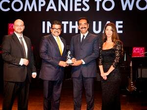 UAE Exchange CEO Promoth Manghat (left) and UAE Exchange President Y Sudhir Kumar Shetty (right) recieving the Great Place to Work Award