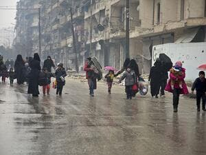 Picking up the pieces: Families in Aleppo roam the streets in search of better amenities (AFP/File Photo)
