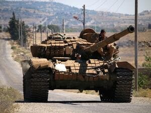 A rebel tank in Quneitra (AFP/FILE)