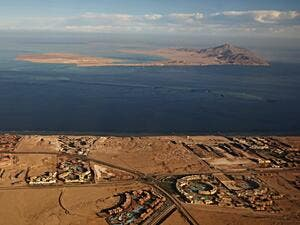 A picture taken on January 14, 2014 shows the Red Sea's Tiran (foreground) and the Sanafir (background) islands in the Strait of Tiran between Egypt's Sinai Peninsula and Saudi Arabia. (AFP/Stringer)