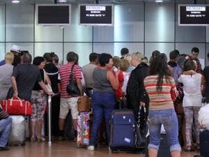 Tourists wait inside the airport in Egypt's Red Sea resort of Sharm el-Sheikh. (AFP/File)