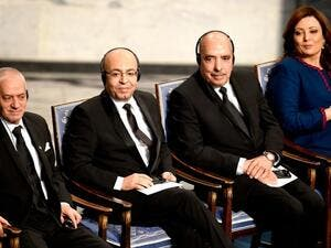 Tunisian National Dialogue Quartet member, Abdessatar Ben Moussa (R) receives the 2015 Nobel Prize medal as fellow Dialogue Quartet members, Houcine Abbassi (L) and Mohamed Fadhel Mahfoudh (2nd L) look on at the ceremony in Oslo on December 10, 2015. (AFP/Odd Andersen)