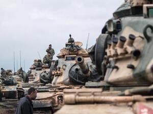 Turkish tanks waiting at the border of Afrin (AFP/FILE)