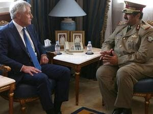 US Secretary of Defense Chuck Hagel (L) meets with Minister of Defense of Qatar, Hamid bin Ali Al-Attiyah, at the Defense Headquarters, on December 10, 2013 at Doha, Qatar. [AFP]