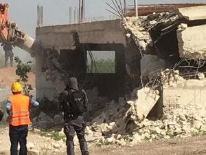 Israeli bulldozers demolished building in Palestinian (Twitter)