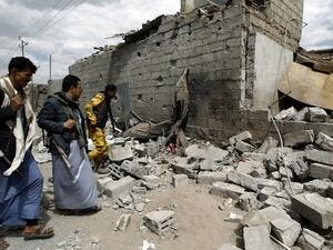 Yemeni men walk amid the ruins of a building in Yemen's Houthi rebel-held capital Sanaa on August 29, 2016, after it was reportedly hit by a Saudi-led coalition air strike. (AFP/Mohammed Huwais)