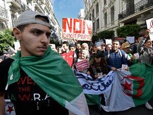 Algerians protest against upcoming elections that they view as a sham. / AFP