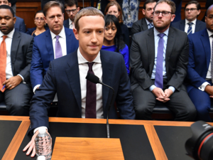 "Facebook Chairman and CEO Mark Zuckerberg arrives to testify before the House Financial Services Committee on ""An Examination of Facebook and Its Impact on the Financial Services and Housing Sectors"" in the Rayburn House Office Building in Washington, DC on October 23, 2019."